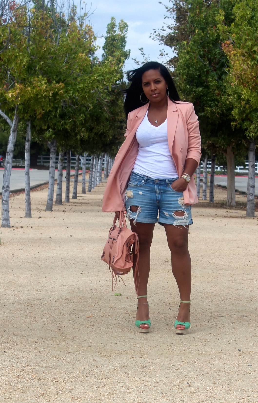 Amazingly sexy Black woman wearing short jeans with open toe sandal pumps shows her ridiculously thick curves.
