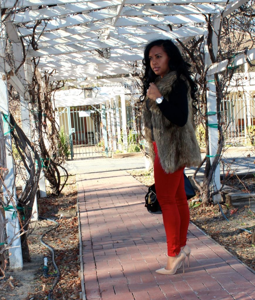 Wearing- fur vest, V-neck sweater, red jeans, Jimmy Choo Pumps, YSL Bag